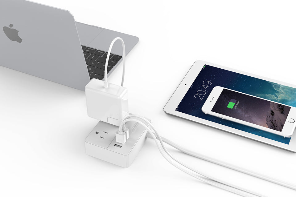 Travel Adapter in real life usage with laptop charger and 2 usb chargers