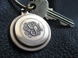 "Solid Bronz eRanch Brand Keychain Fob with Solid Brass key ring Approx 1""  1/8"" (2.4 cm.) in diameter"