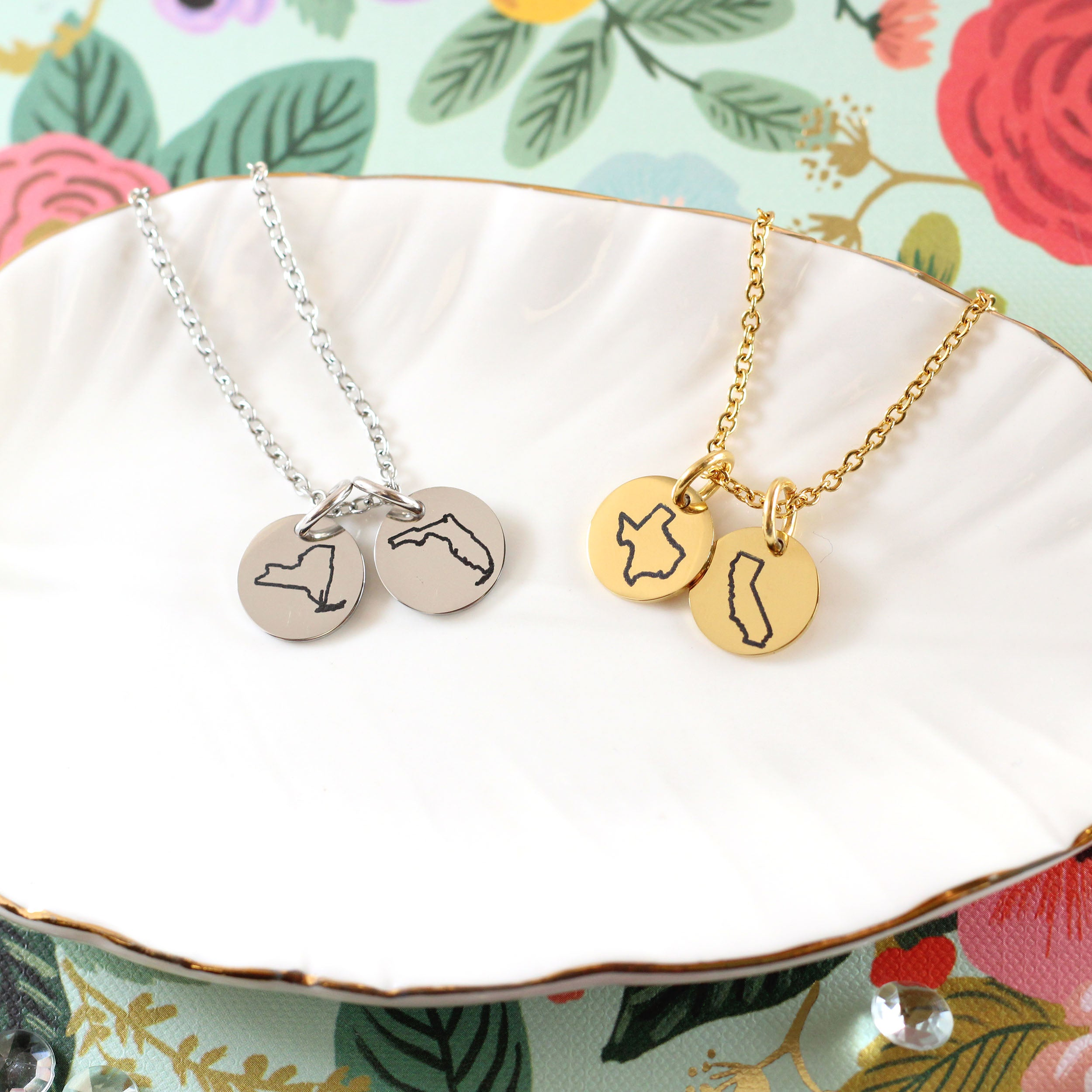 Gold and Silver State Necklaces on Tray