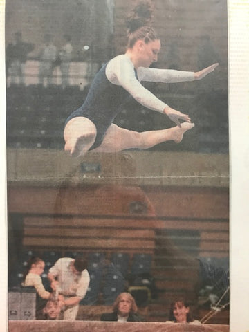 Meghan leaping on beam