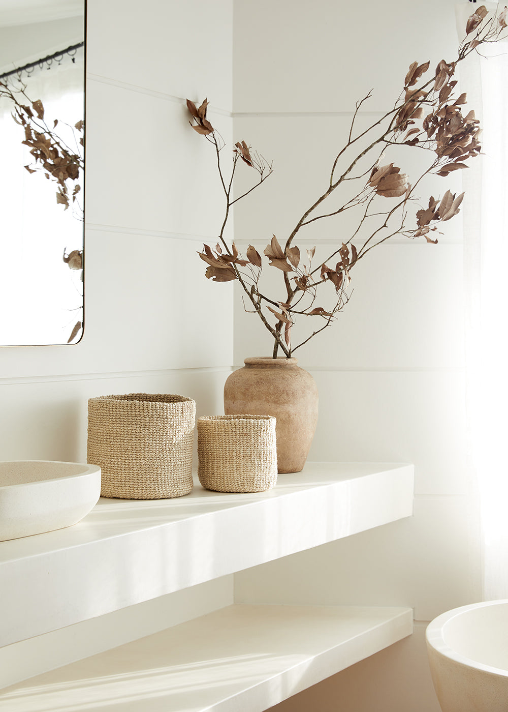 Jute storage baskets used in a bathroom vanity.