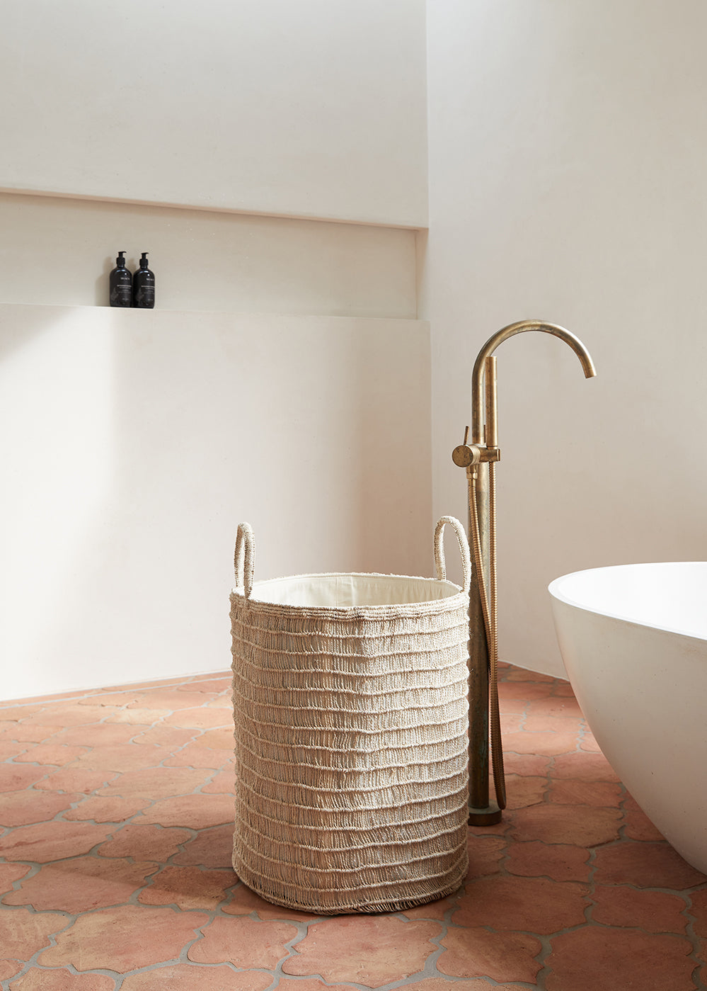 Natural jute laundry basket used to organise in bathroom