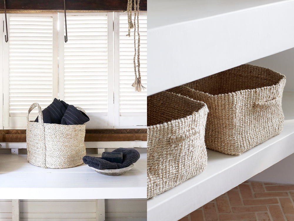 Small jute storage basket used in a bathroom for storing accessories, cosmetics and beauty tools.