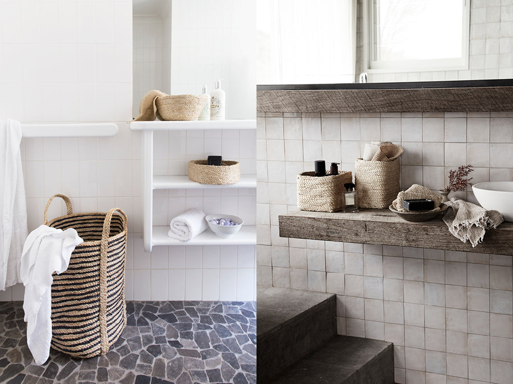 Striped jute storage basket used in a bathroom for storing towels.