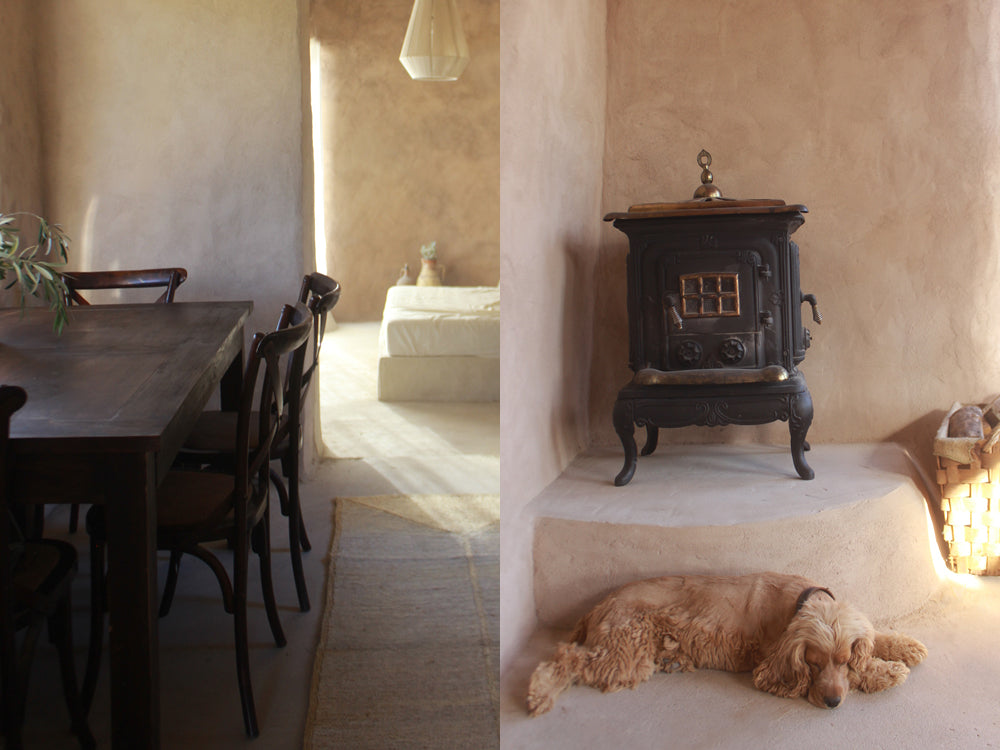 Maison de Base - a hallway with natural jute runner looking into a bedroom. A puppy sleeping in front of an old fire place.