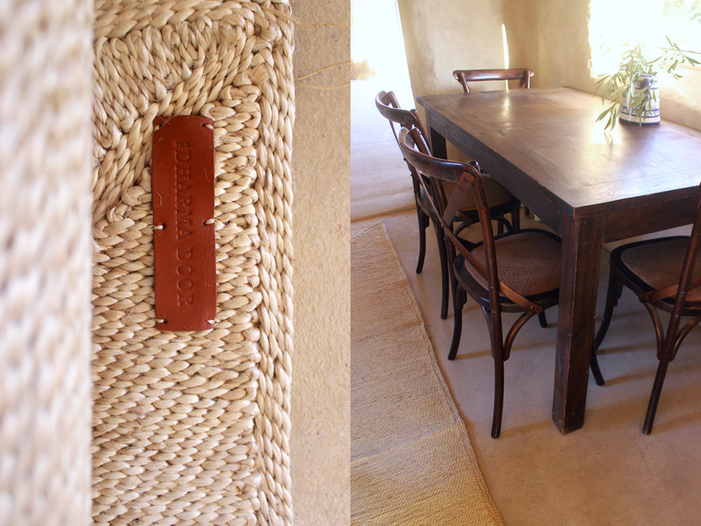 Maison de Base - Amada Jute runner in front of a dark stained wooden table setting.