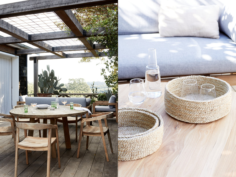 Ourdoor dining area at Le Viti. Close up of woven jute baskets on table used to hold glasses.