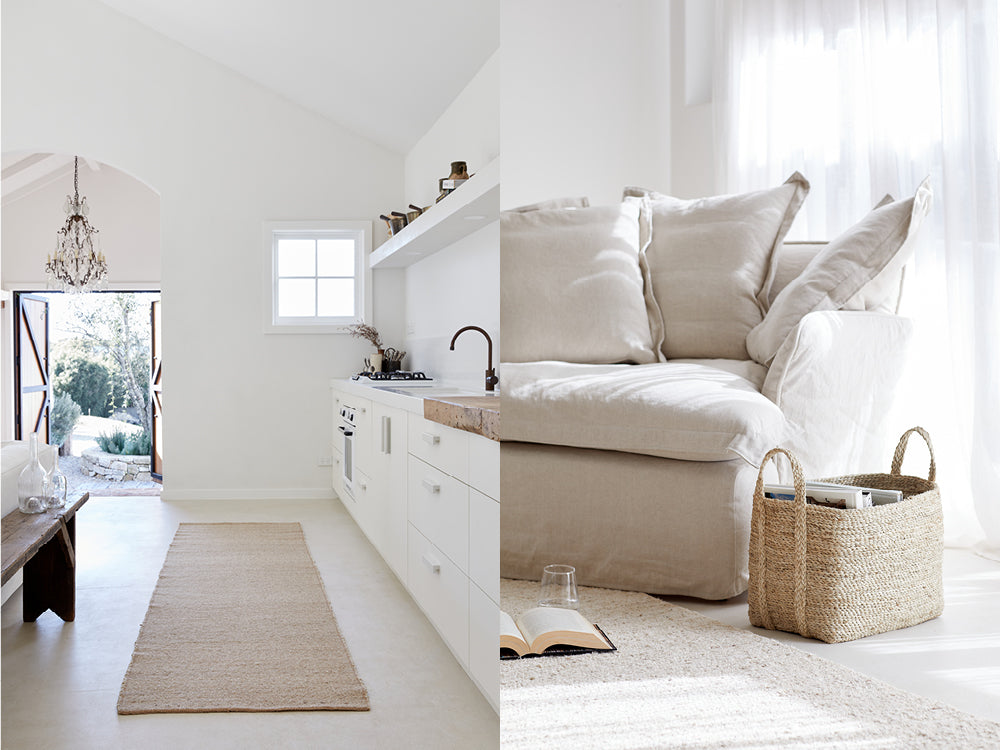 The kitchen at Le Viti in white and neutral tones. Image of a neutral couch with a handwoven jute basket next to it.