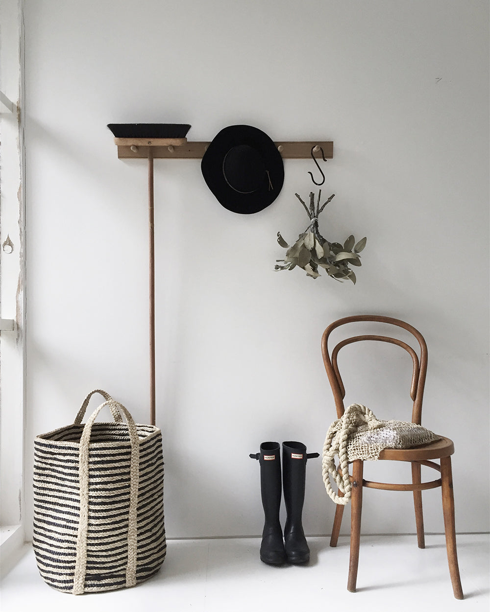 jute basket with chair and rain boots