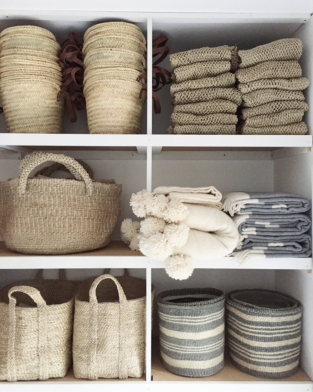 cupboard with jute baskets and throws