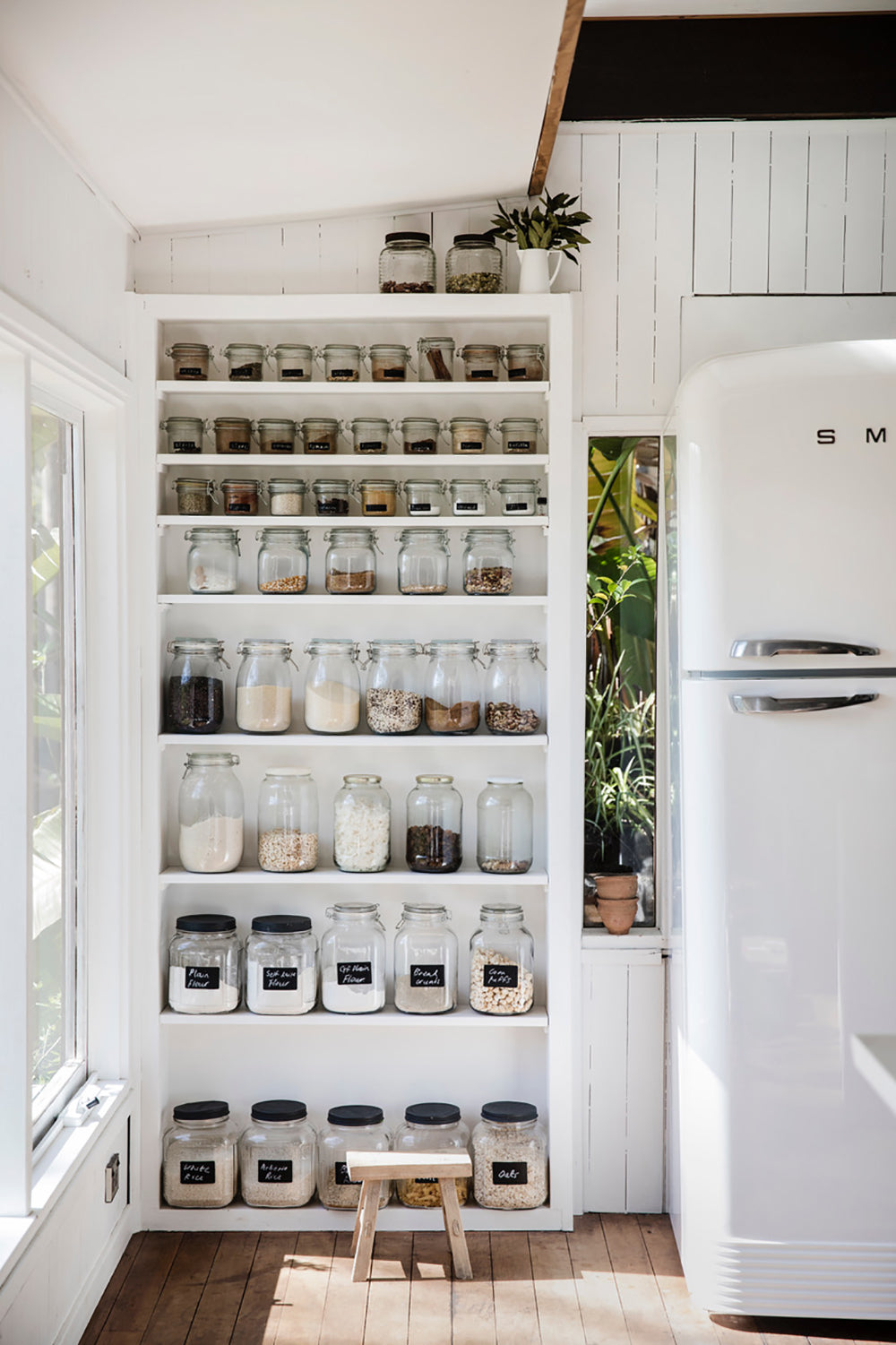cupboard with spices in jugs