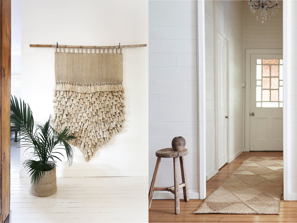 Woven tassel wall hanging on white wall. Entryway with textured jute runner.