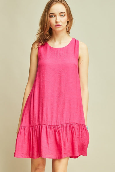 Open-back dress with pom pom detail in hot pink.