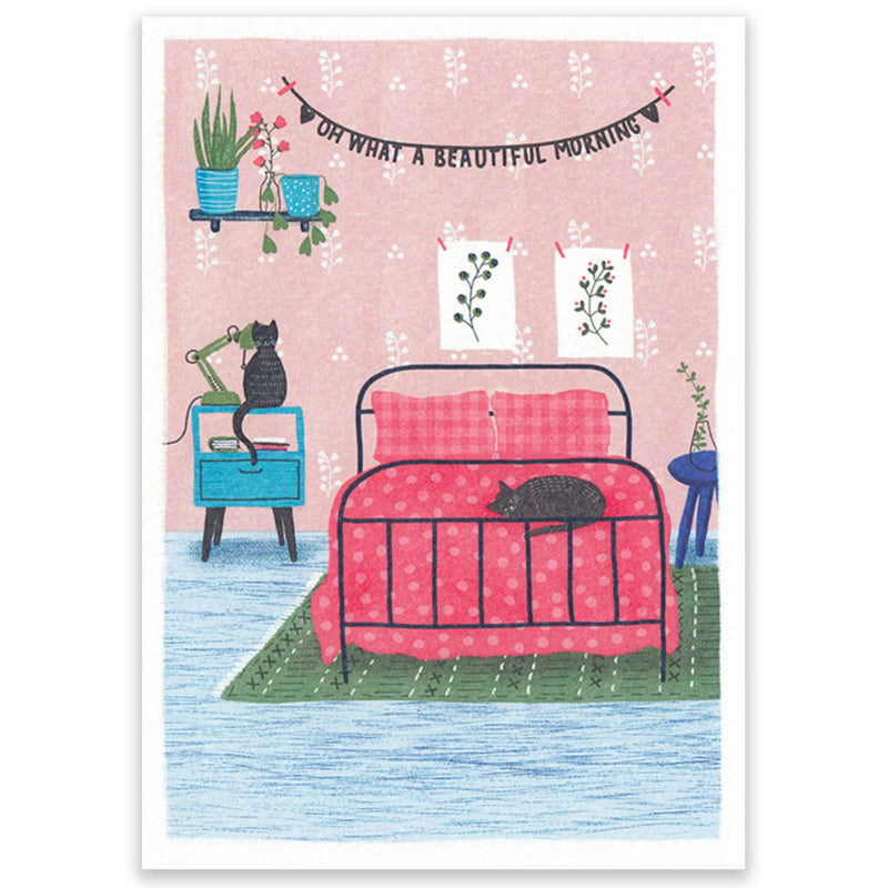 Postcard with a pink bedroom and two black cats