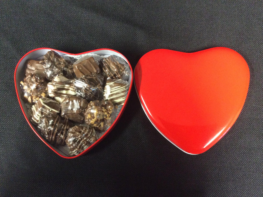 Heart Shaped Tin filled with Handmade Robicheaux Chocolates.