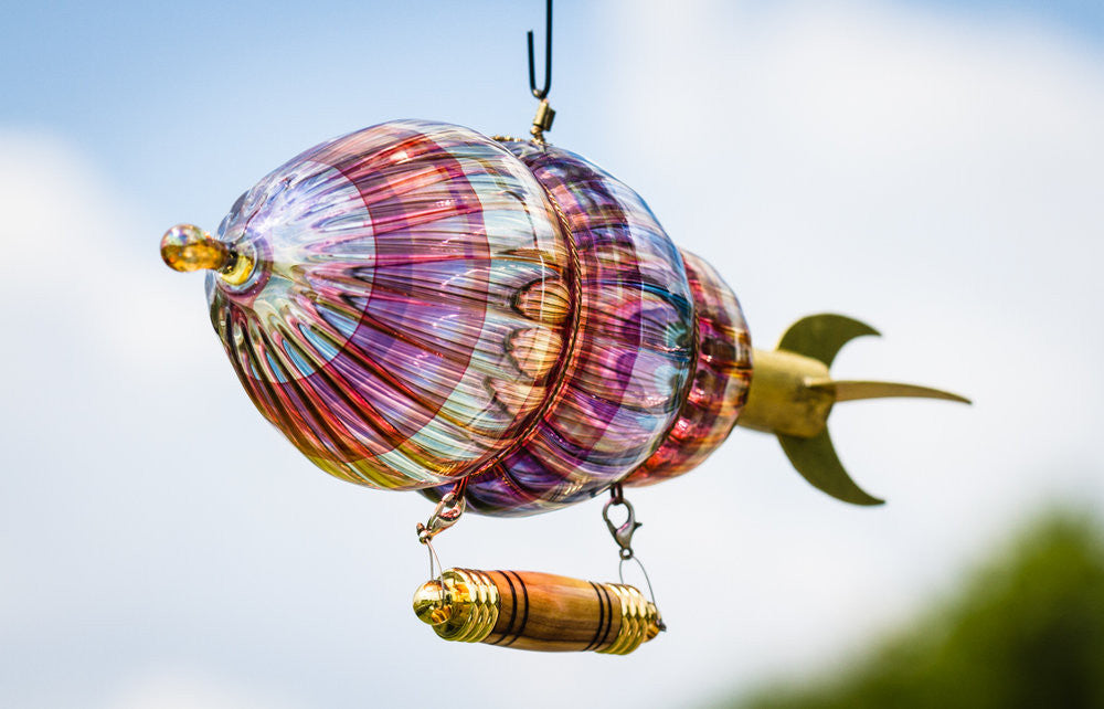Our flying airship with wooden keepsake urn - soar to heaven in style!
