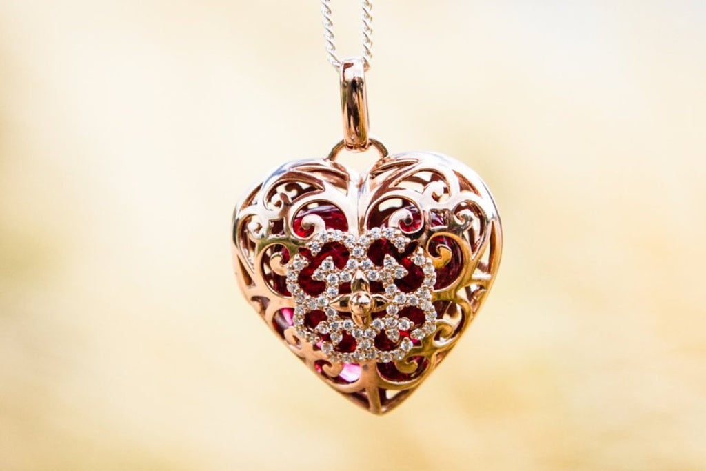 Cremation Jewelry Pendant with Glass Heart Holding Cremains