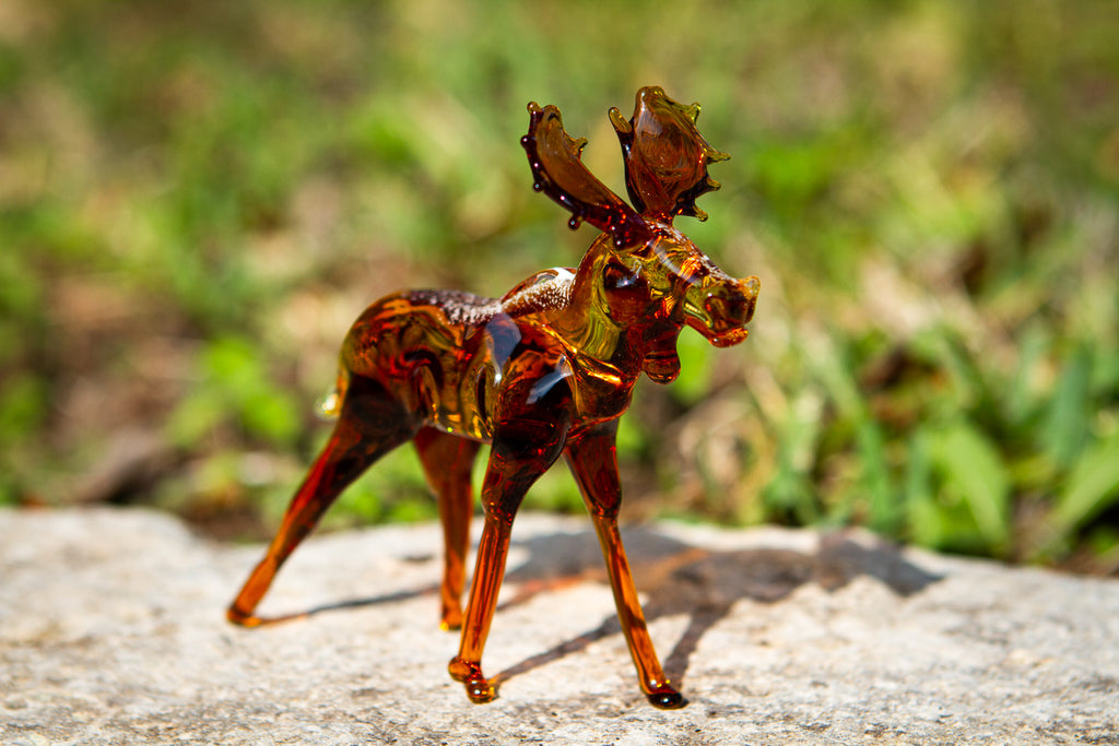 glass moose with ashes