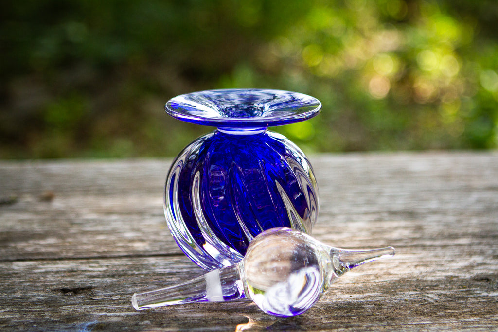 glass urn with ash