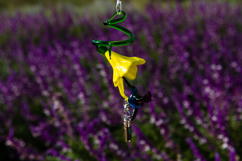 Glass Flower with Hummingbird Figurine and Silver Keepsake for Ashes by Spirit Pieces - SUNCATCHER | $109.00, ashes in glass
