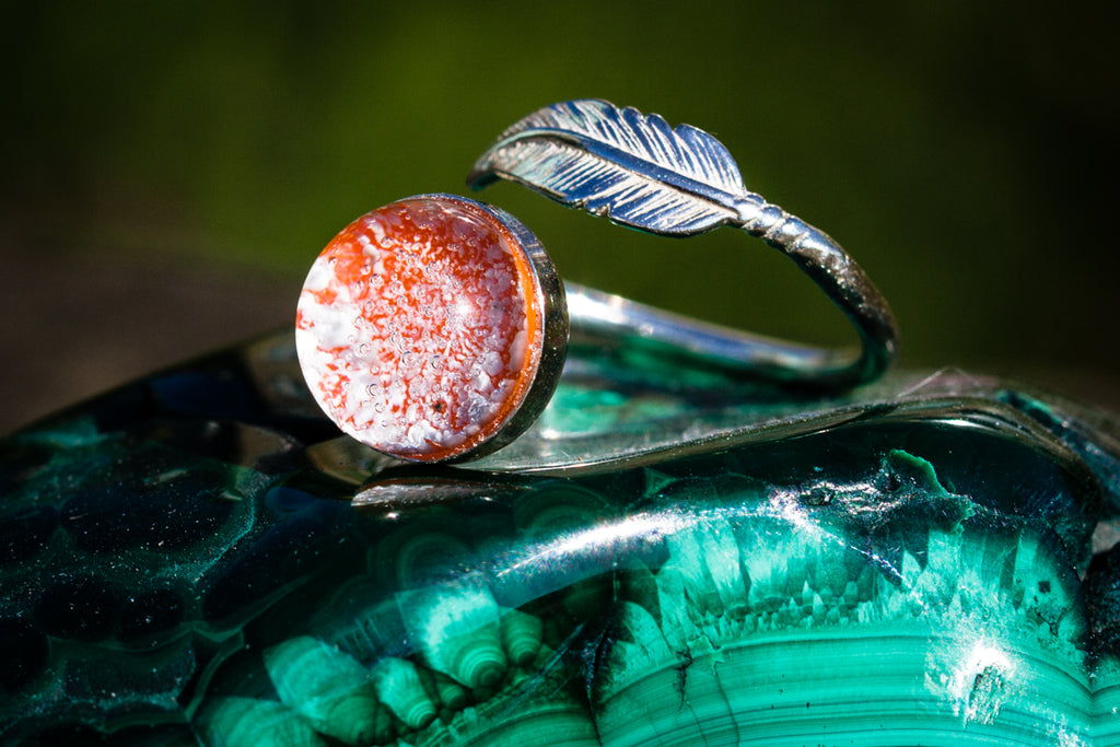 silver ring with feather and glass cabochon