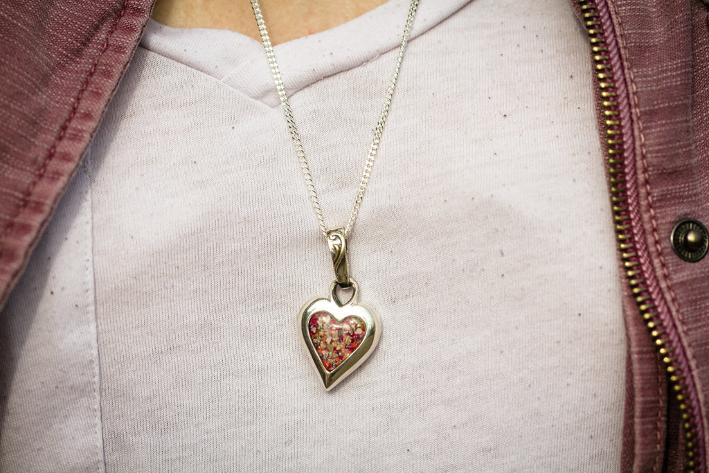 silver heart cremation jewelry being worn