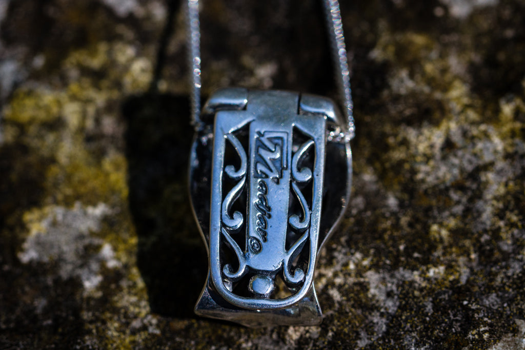 filigree pendant with ash