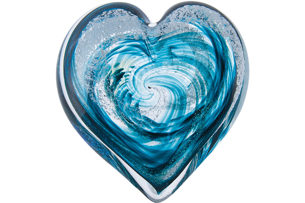 turning ashes into glass in the form of a teal heart to celebrate life and love