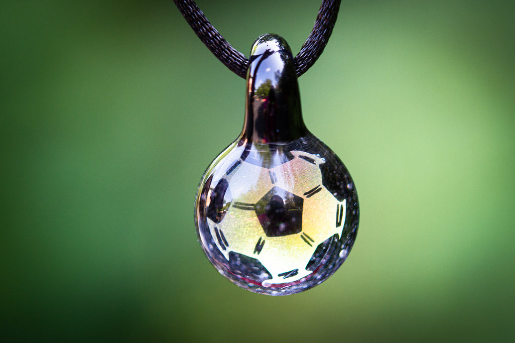 glass soccer ball with ashes