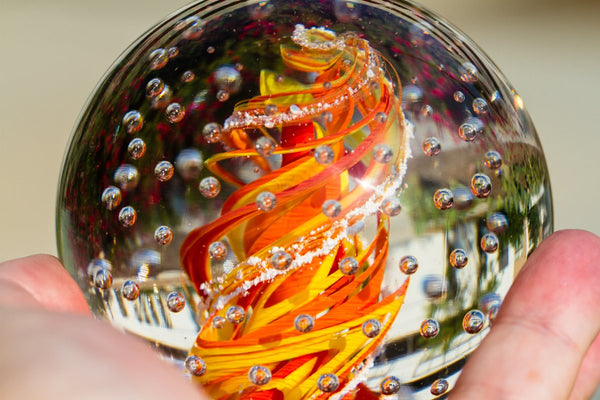 Illuminated Spiral Bubble Flame Paperweight with Infused