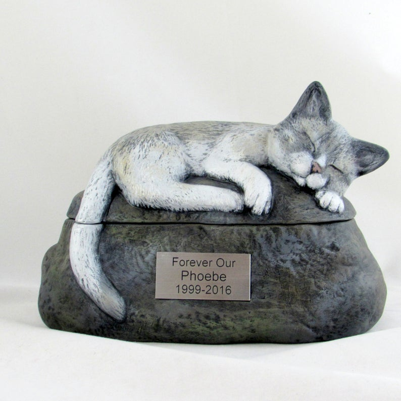 cat urns with lifelike statues of cats