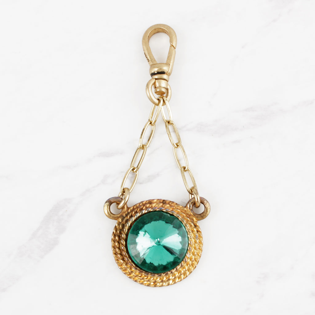 Vintage 1960's Vibrant Emerald Green Glass and 10 Karat Gold-Plated Hypnotique Charm