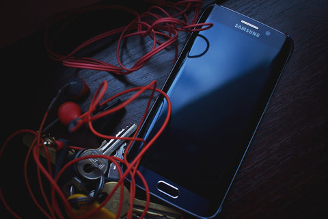Headphones Tangled Wires and Mobile Phone