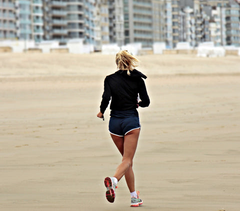 Running Female in shorts on Beach