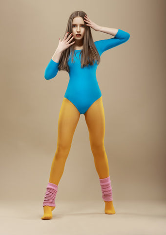 Woman in Blue Gym Leotard and Mustard Tights