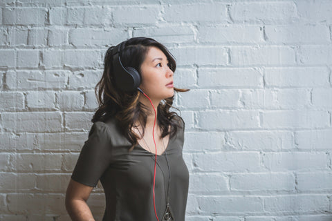 Woman wearing noise-cancelling headphones