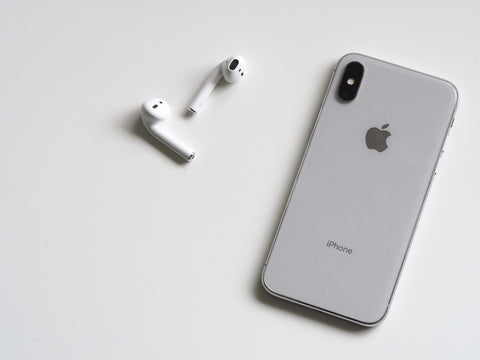 Apple airbus and an iPhone on a white table