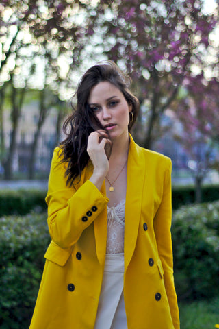 Young woman wearing yellow coat