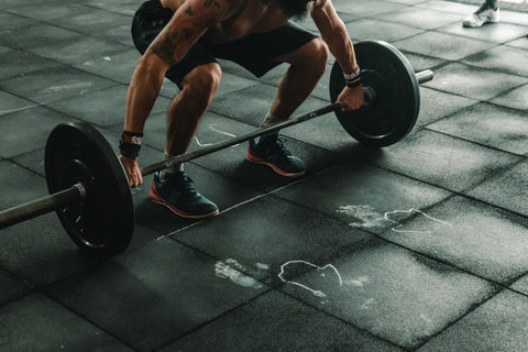 man ready to life barbell in gym