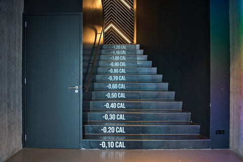 Calorie amounts written on gym steps