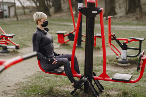 outdoor gym woman in covid-19 facemask