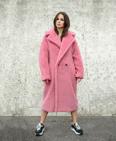 Woman in fluffy pink coat