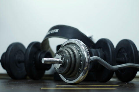 Weightlifting dumbells with headphones