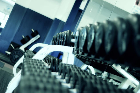 Dumbbells on racks in gym