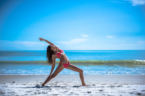 Yoga Woman Working Out on Beach