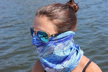 woman with ocean reflection in sunglasses wearing waves neck gaiter mask
