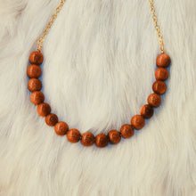 Sarah Choker Necklace that Gives Back to Charity by ROX in  Burnt Orange Goldstone and Gold – Trendy and Affordable Perfect for Gameday Necklace that Gives Burnt Orange Sparkly Stone Jewelry - modern take on classic pearl choker