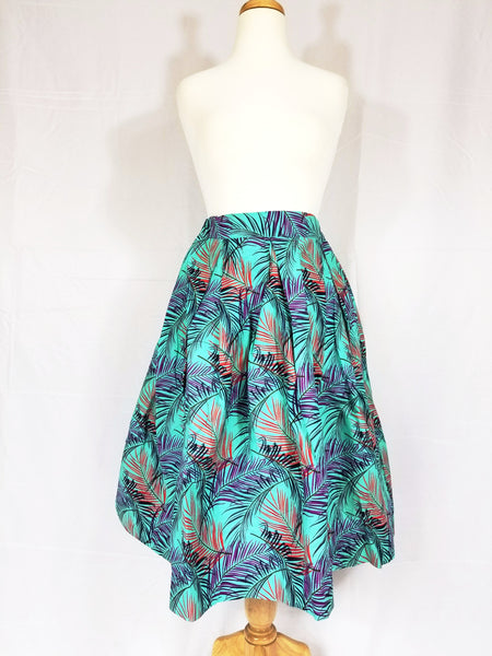 OLA ankara knee-length skirt in turquoise print with feathers