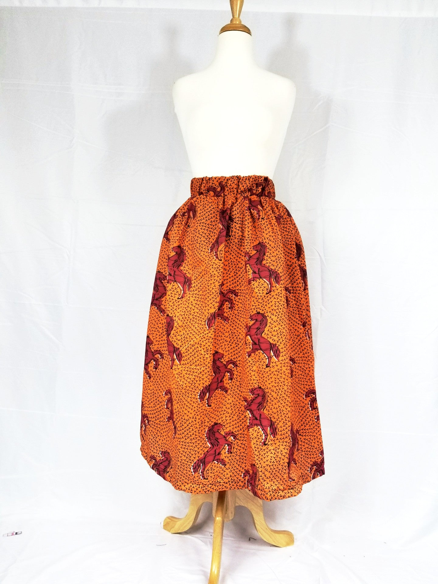 DUPE Ankara silk tea-length skirt (Red horse)