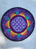 Endless knot in rainbow petals